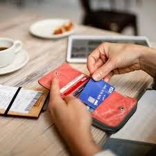 person taking visa card from wallet