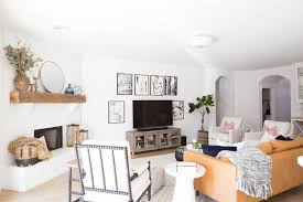 white painted brick fireplace makeover tv collage wall pottery barn wood media console article sven leather