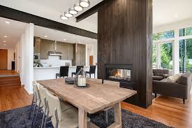Double sided fireplace. 2 tags Contemporary Great Room with flush light,  Hardwood floors, Blackened steel beam, metal fireplace
