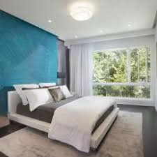 Modern Small Bedroom With Blue Accent Wall