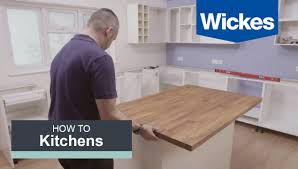 buliding kitchen island wood countertop white table wooden floor cabinet drawer storage rack take the guesswork