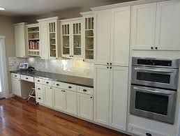 open oven in kitchen. white shaker kitchen cabinets glass doors open shelving cabinet wall oven black granite countertops in n