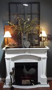 farmhouse living room furniture ideas feature modern white colored surround mantel decorated and plants