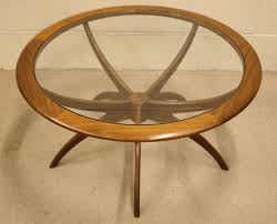 glass form furniture. a glass shaped circular with wood swathed at the edge in wooden dining table furniture form f
