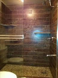 wood floor tiles bathroom. Guest Bathroom Roman Shower. Pebble Floor And Wood Tile. Luxury At Its Best Tiles