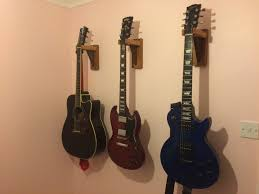 i had previously been using some fold out metal guitar stands to hold my guitars they did the job but they took up floor space and weren t always in the