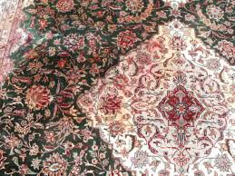 red dye bleed on a silk rug from pet urine