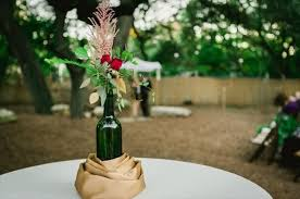 Empty Glass Bottles Fill In Gorgeous Wedding Centerpieces: