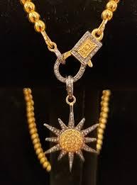 hematite with pave diamond sun pendant
