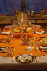 dining room great dinner table setting and decoration design orange table cloth clear glass goblet