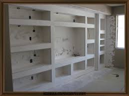 Built In Drywall Shelves Showing A Big Entertainment Center After Its Been Framed