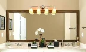 above mirror lighting. Vanity Light Above Mirror Floor Dazzling Lighting Bathroom Co Plush Lights . E