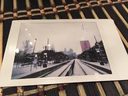 polaroid picture of a snowy uptown charlotte on the last snow day for cms