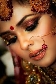 indian bridal makeup and jewellery nose ring and maang tikka love the smokey eye makeup