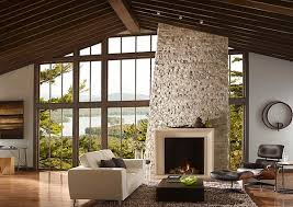 View in gallery Stone fireplace with a wooden mantel