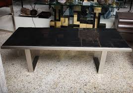 known for her ceramic tile pieces in the 70 s this witty modernist coffee table
