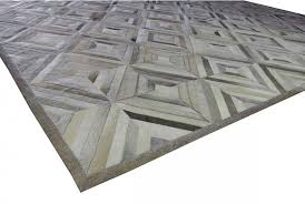 taupe and cream diamond patchwork cowhide rug