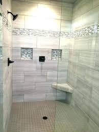 light grey shower tile ideas with corner bench using glass door for elegant bathroom ideas with black hardware