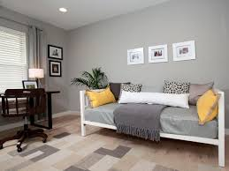 bed for office. This Serene Home Office Features A Comfortable Day Bed For Guests. The Bedding Is Mix Of Soft White And Gray With Yellow Accents, Which Compliment