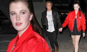 Ireland Baldwin holds hands with boyfriend Noah Schweizer in West ...
