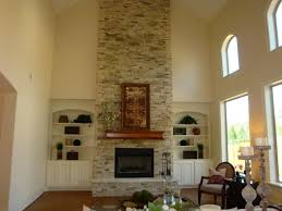mesmerizing fireplace decoration with stone fireplace surround handsome living room design ideas with high ceiling