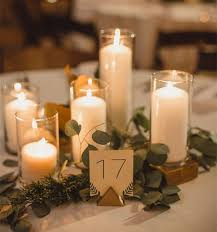 Candle Centerpieces with Round Glass Garnished with Leaves