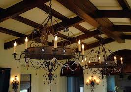 hanging candles from ceiling interior ceiling designed with wooden beams and illuminated with hanging wrought iron chandeliers ceiling hanging candle