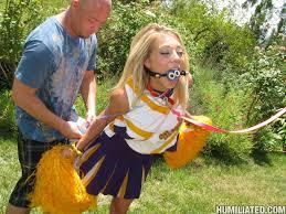 Hot cheerleader in bondage