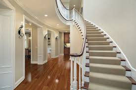 best luxury vinyl wood plank flooring for hallway under staircase modern house design with cream wall interior color and mounted lamp plus ceiling track