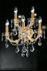 single scrolled 5 light crystal and gold plated metal wall light