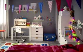 a children s room with a white desk that can be adjusted in three diffe heights as