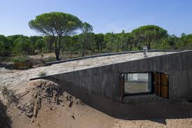 concrete house buried under artificial sand dunes 1 roof diy