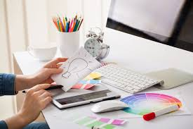 Graphic Designer At Desk