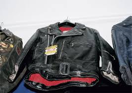 note the leather buckle that won t scratch the tank it wasn t just the bikers who were wearing the look it was being worn on the streets