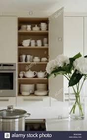 Open Kitchen Cupboard Open Crockery Cupboard In White Contemporary Kitchen Stock Photo