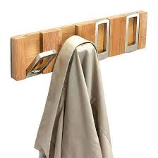 these modern coat hooks are so cool and they fold up when not in use