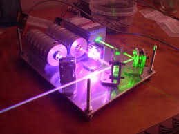 remember carl that made the spinning rgb led ball display he has also built a wicked rgv laser system i can just imagine using this at the center of a big