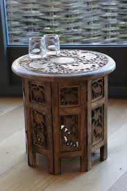 Handmade coffee table with natural embossed leather, natural wood, holland. Mangowood Elephant Carved Octagonal Side Table Natural Living Online