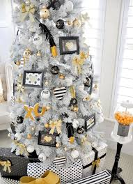 white tree with whimsy white, black and gold decor