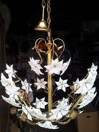four light chandelier in brass and with glass flowers