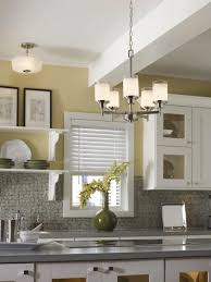 well illuminated kitchen with a variety of storage