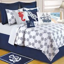 navy blue and white nautical quilts bedding set added by red seahorse pillow cover on white bedroom over beige laminate floor