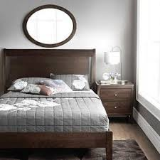 grey and brown furniture. i love how simple this is and that they were not afraid to mix grey brown furniturewooden furniture e