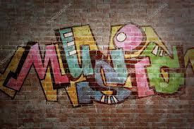 colorful word on brick wall background graffiti style photo by belchonock