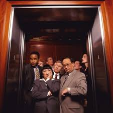 people inside elevator. another people inside elevator