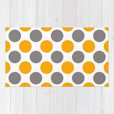 gray and yellow polka dots rug