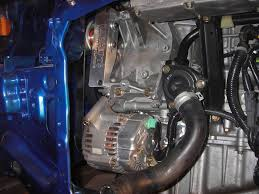 at this point you are ready to put the engine in the easy way is from the bottom with a lift but who has a lift we don t