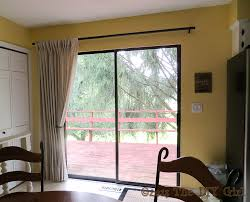 patio door curtain rods with wooden deck pattern and sliding door system