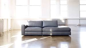 design within reach sofa light grey colour rectangular shaped wooden floor  large windows bright atmophere big