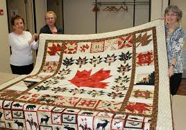 Providing real comfort to injured vets   Sarnia and Lambton County ... & Laverne Phills (right) and volunteers hold up a Sarnia-made Quilt of Valour Adamdwight.com